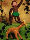 Vintage giraffe and monkey toys.
