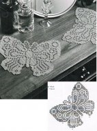Fine crochet butterfly shaped doilly / mat