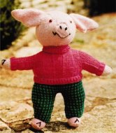 Cuddly piglet toy in clothes