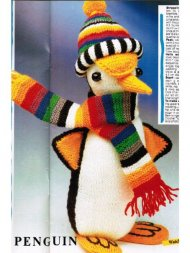 Toy penguin with stripey hat & scarf